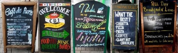 Boards outside some of the cafe's on Mill Road: (L-R) Cafe De Paris, CB1, Neide's Deli Cafe, Limoncello & Cafe Otto.
